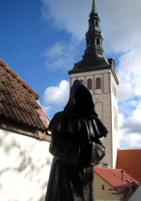 Dark statues of monk ghosts near the Danish Kings Gardens